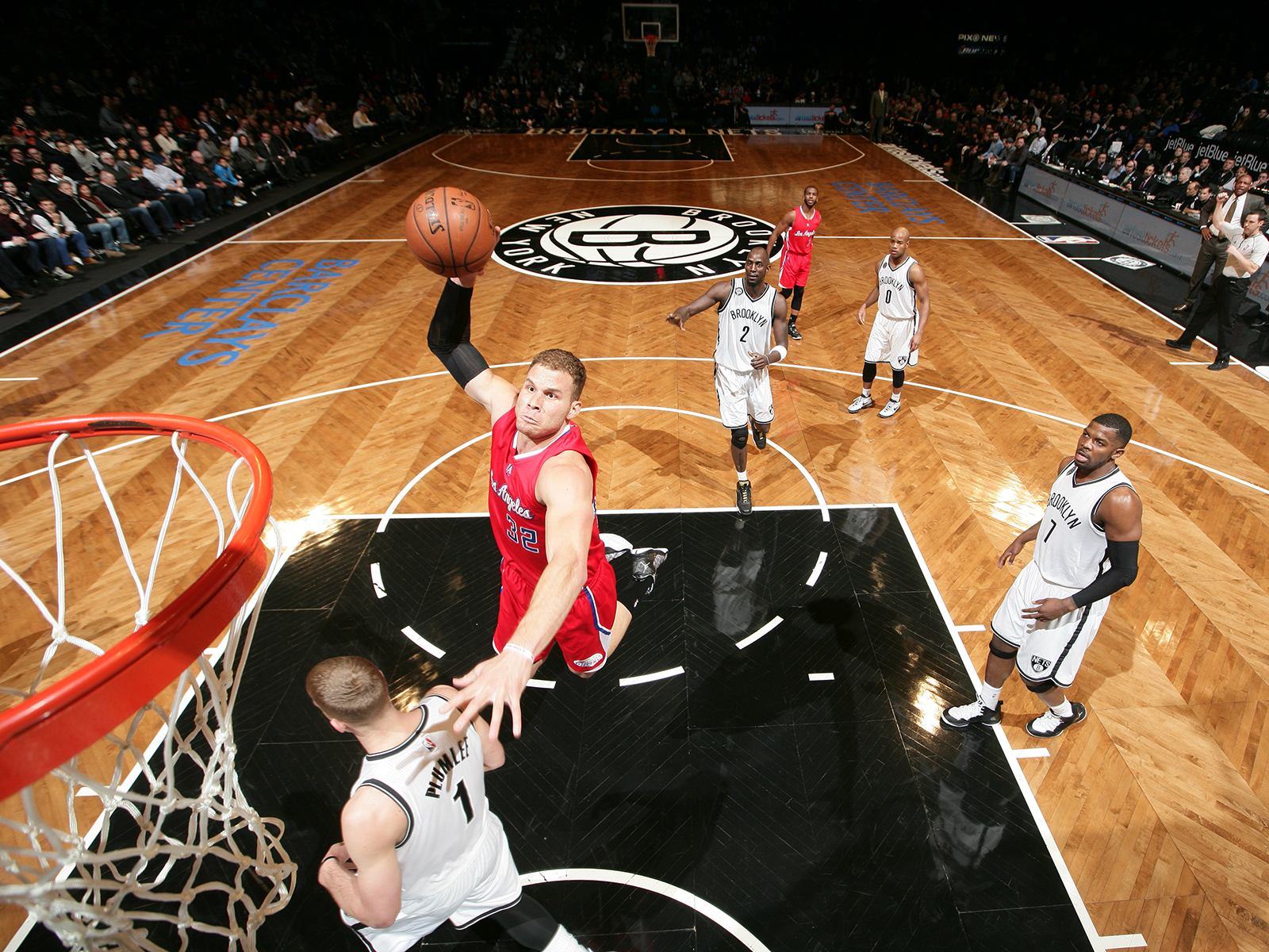 Blake Griffin uses Mason Plumlee's shoulder as a boost for a big one-handed dunk against the Brooklyn Nets.