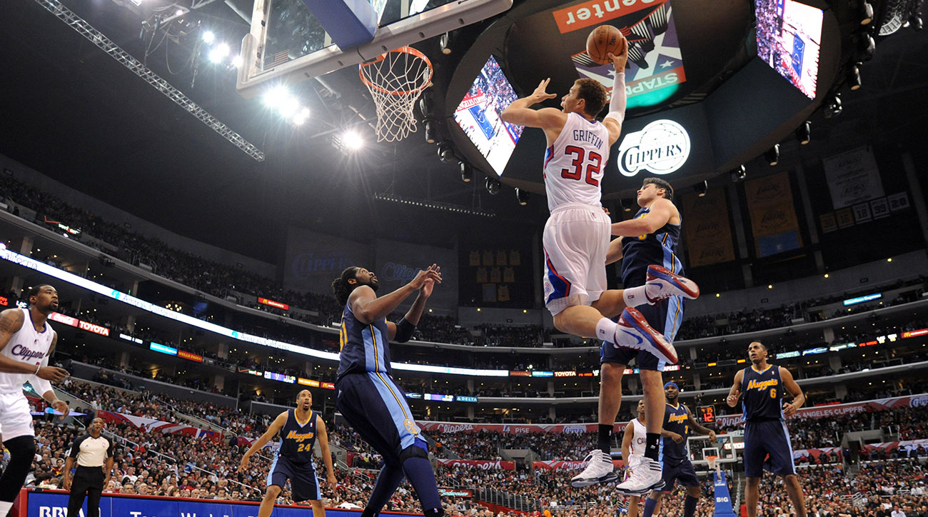 Members of the Denver Nuggets clear the lane as Blake Griffin throws down a dunk.