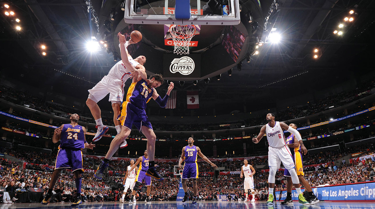 Blake Griffin takes off for a dunk as a helpless Pau Gasol jumps nearby.