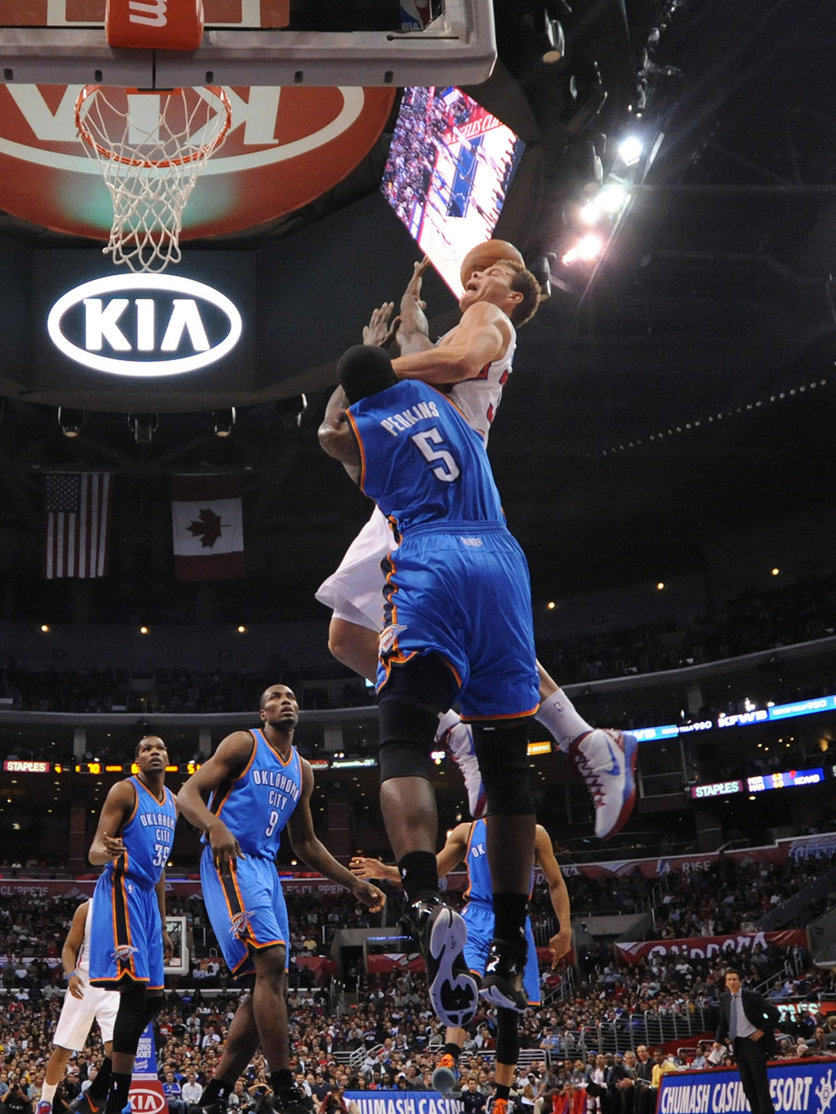 Blake Griffin meets Kendrick Perkins in the air before throwing down a dunk against the Oklahoma City Thunder.