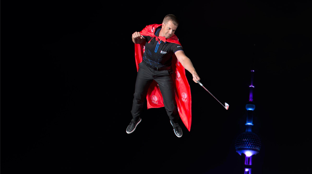 Henrik Stenson hangs from the air during a promotional event for the WGC-HSBC Champions.