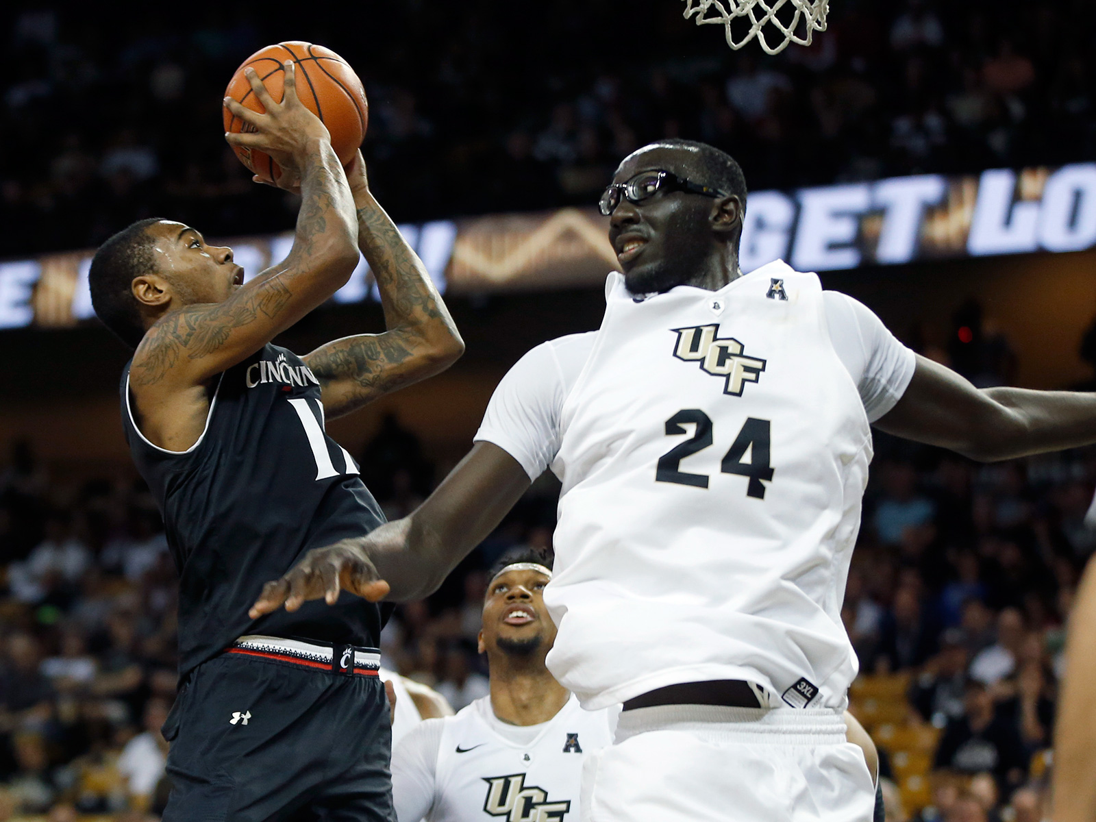Cincinnati's Gary Clark and UCF's Tacko Fall could help their respective teams surprise people this winter.