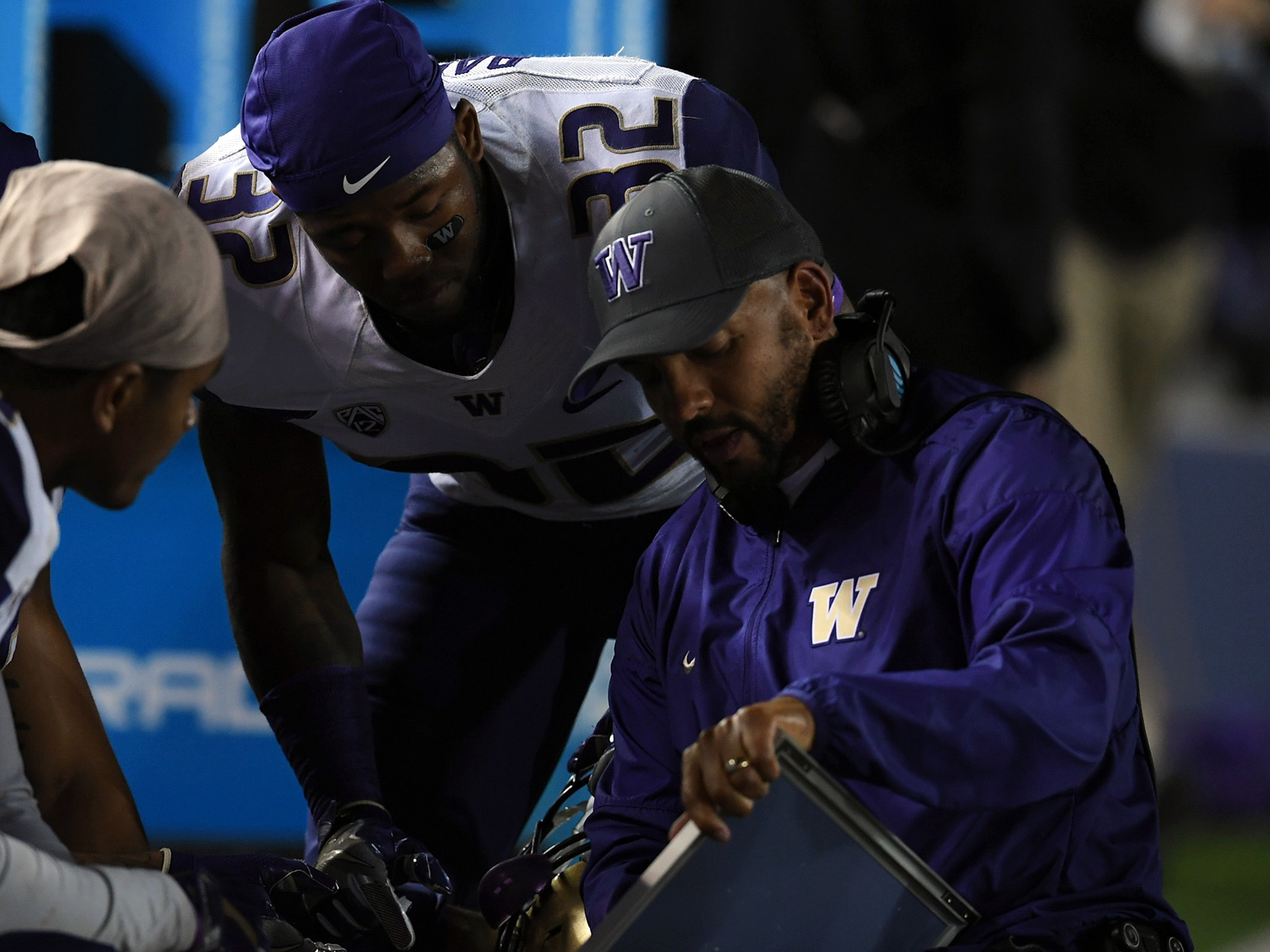 Co-defensive coordinator Jimmy Lake and all-purpose defensive back Budda Baker (32) helped Washington secure its first playoff trip last season.
