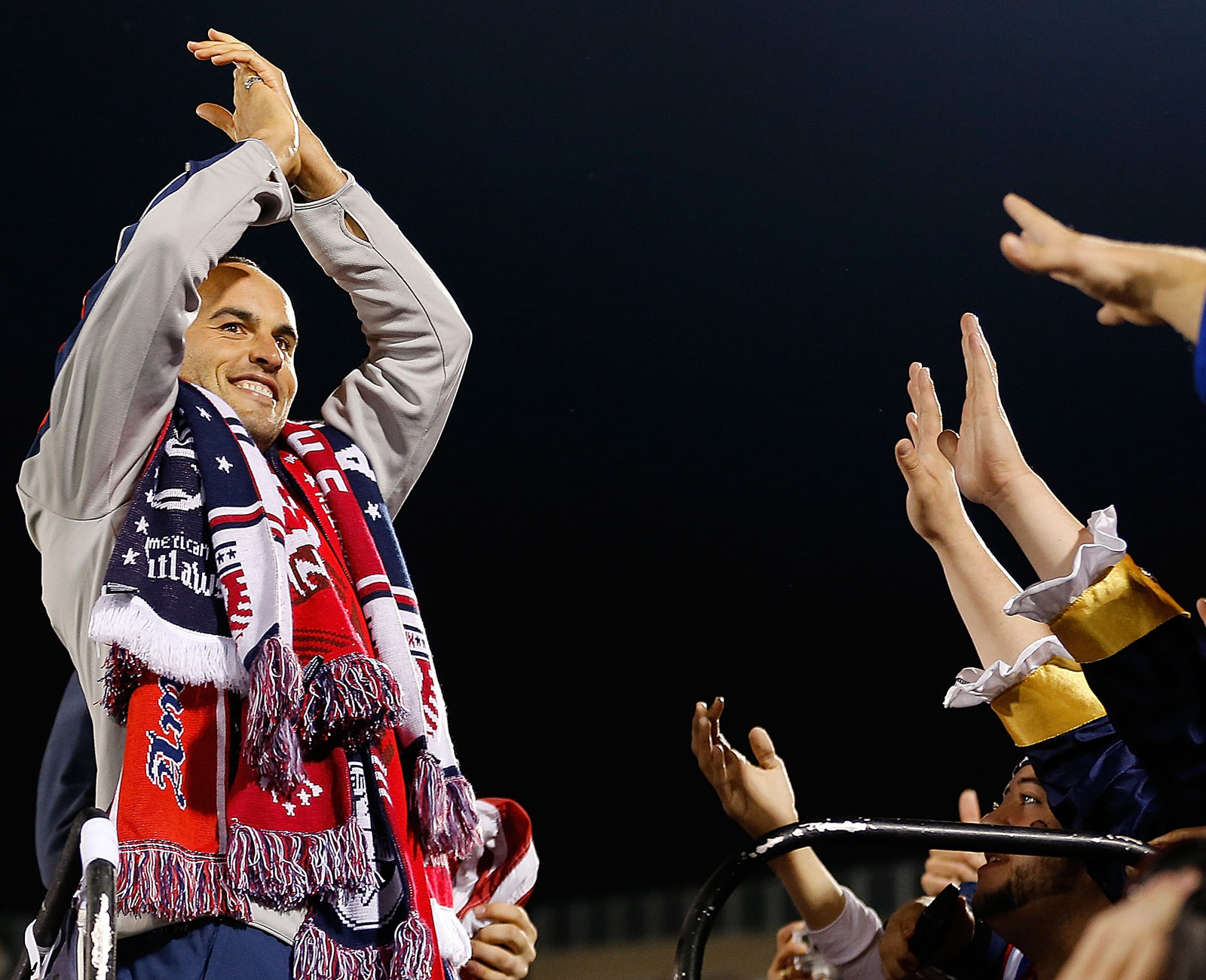 Landon Donovan in front of US Soccer supporters the American Outlaws