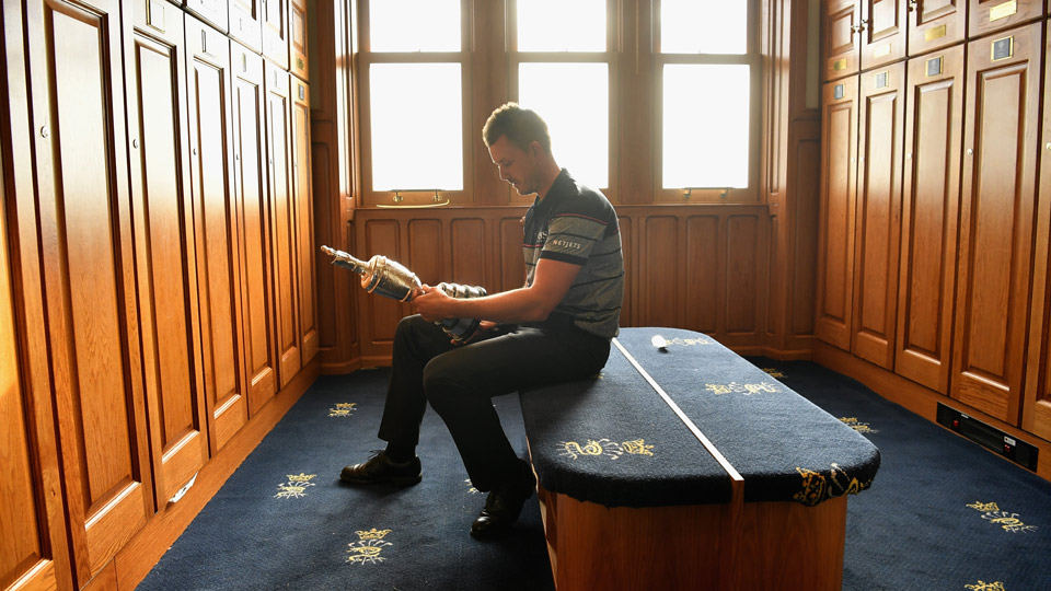 Stensonshared a quiet moment with the Claret Jug in the Royal Troon locker room in 2016.