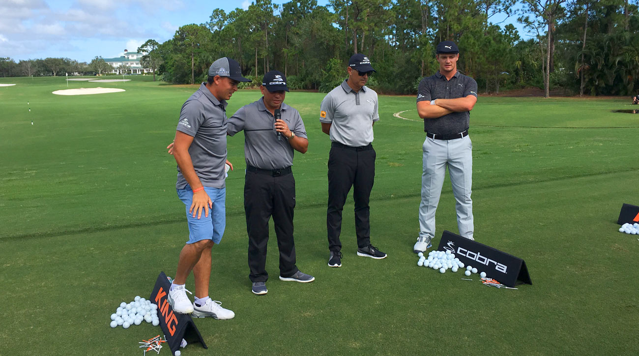 Bryson DeChambeau (far right) and Rickie Fowler (far left) test out Cobra's new F8 irons in front of media members.
