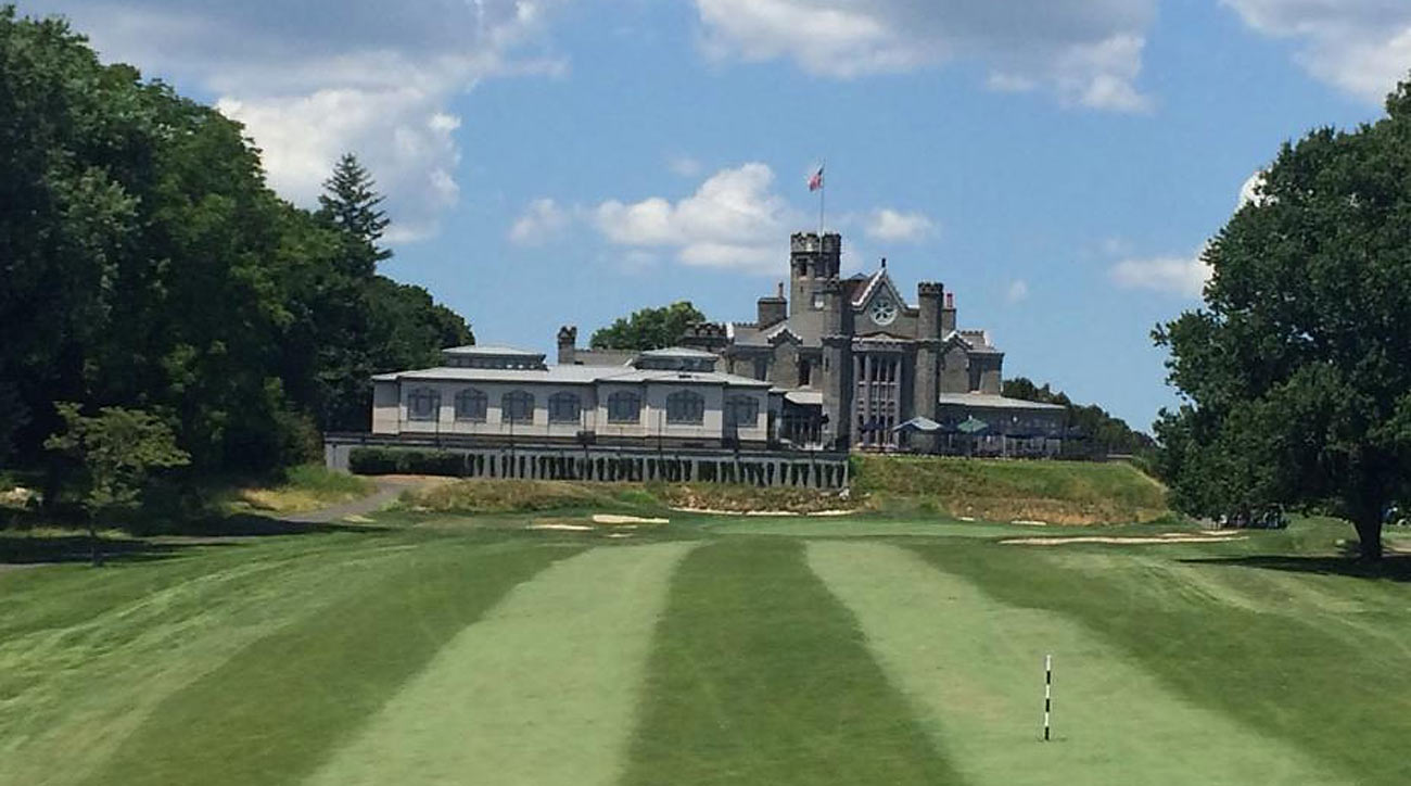 A stately 19th century mansion backs the 18th green.