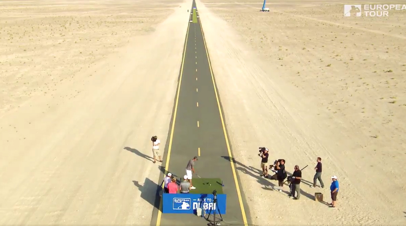 Euro tour pros try to hit a narrow fairway in the middle of the desert in Dubai.