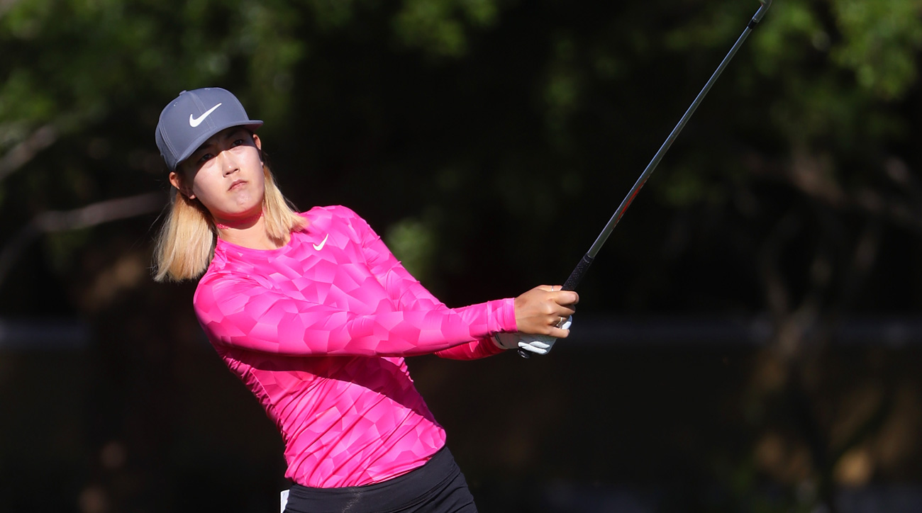 Michelle Wie plays a shot on the first hole during round three of the CME Group Tour Championship.