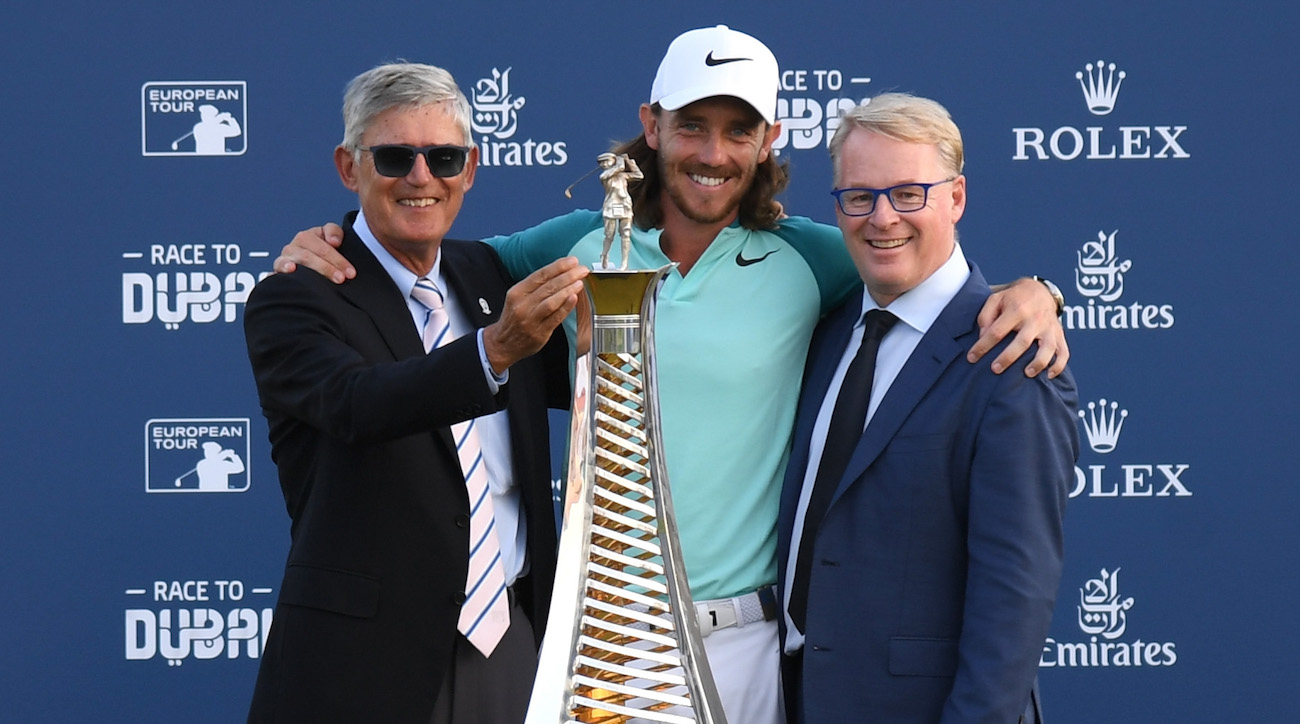 European tour CEO Keith Pelley (right) presents Tommy Fleetwood with the season-long Race to Dubai trophy at the conclusion of Sunday's DP World Tour Championship.