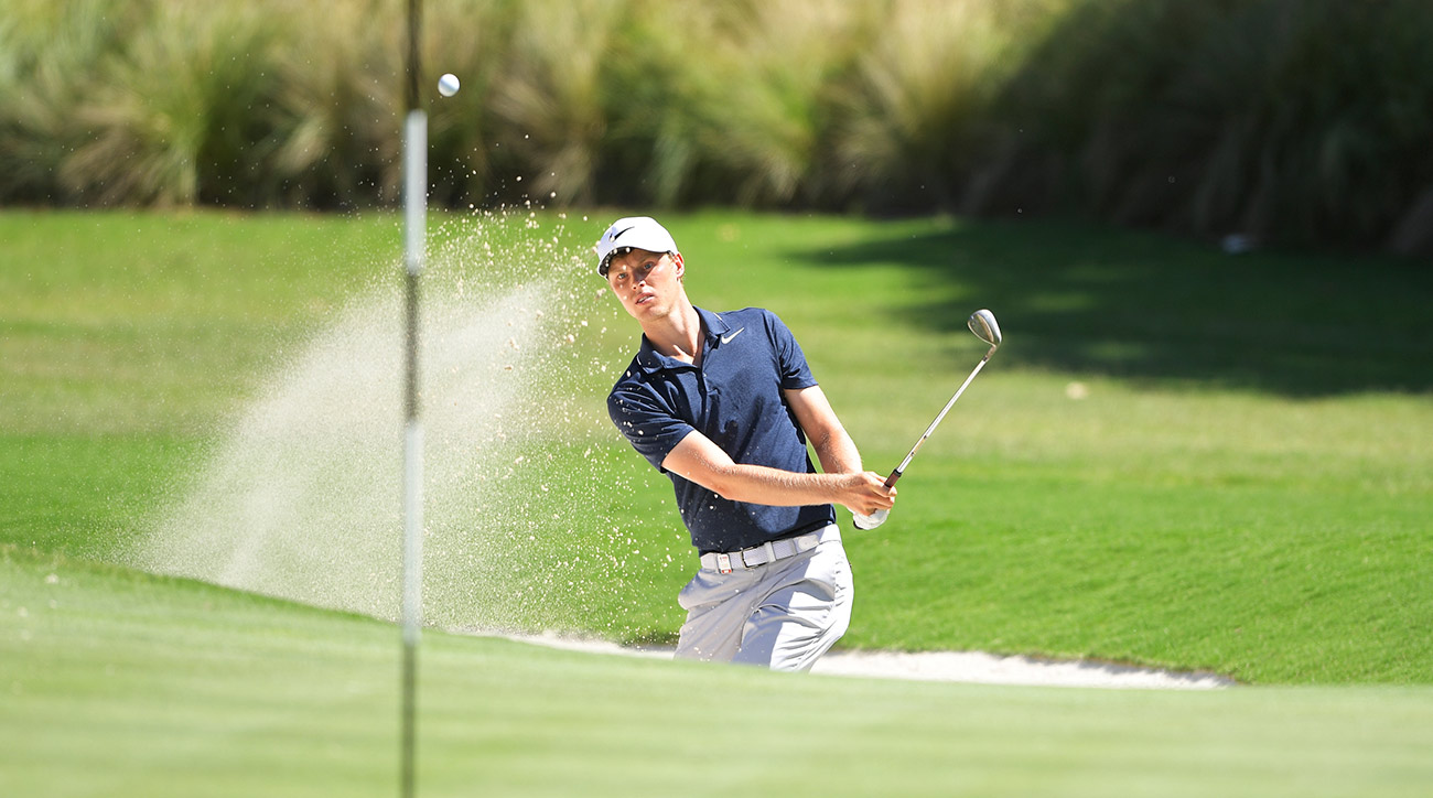 Cameron Davis plays a bunker shot on the 15th hole during the final day of the Australian Open.