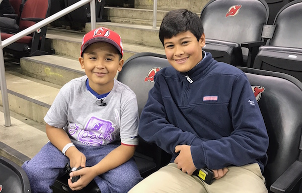 <p>Devils coach for the day Abdiel Collazo with Kid Reporter Christopher John</p>