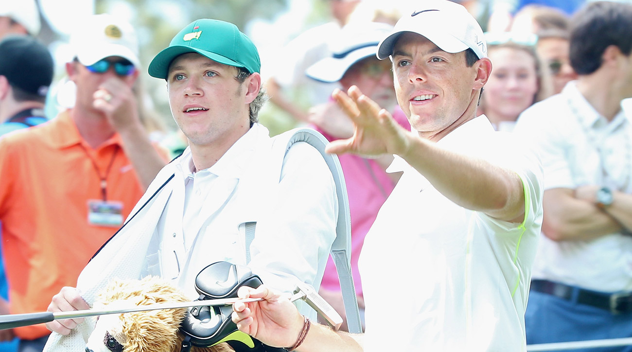 Niall Horan caddied for McIlroy at the 2015 Masters.