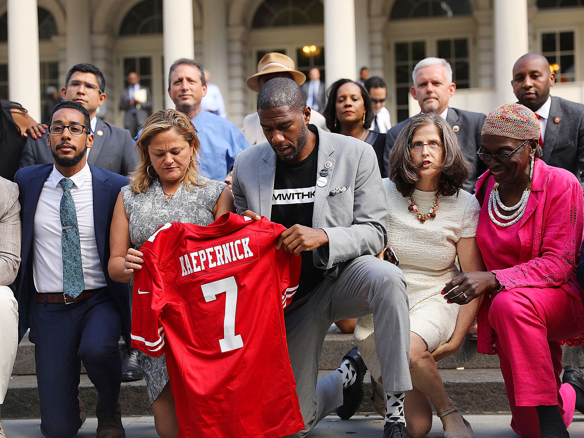 New York City Council members take a knee on the steps of City Hall after Donald Trump condemned the NFL players who choose to kneel.