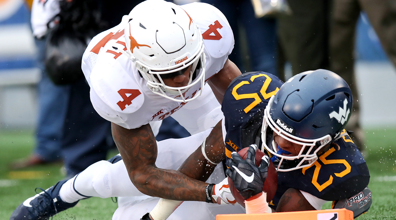 """Elliott emerged as a big-play artist for the Longhorns early in the season, taking a pair of interceptions back for touchdowns. His playmaking ability at 6'2"""" and 210 pounds makes his early jump to the NFL completely understandable."""