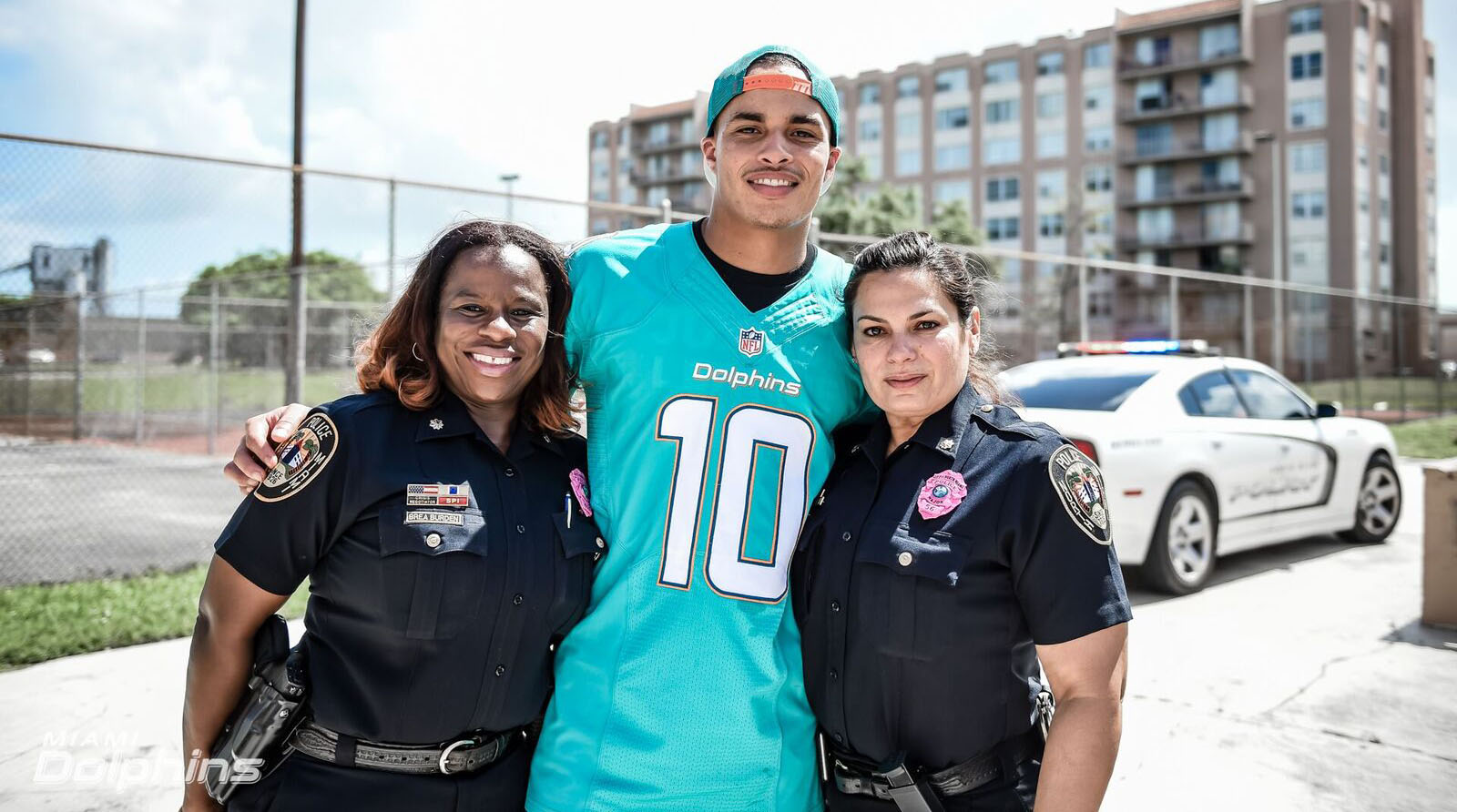 Dolphins receiver Kenny Stills works with local police officers to improve their relationship with the Miami community.