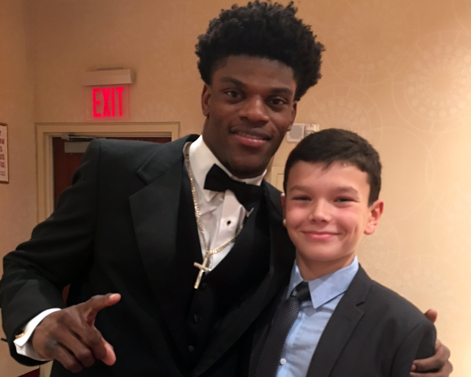 The author's son Julian with 2016 winner Lamar Jackson.