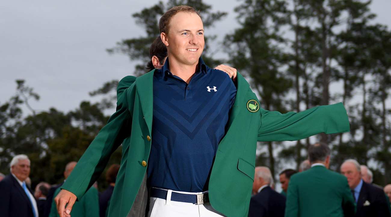Jordan Spieth is presented with his green jacket after the final round of the 2015 Masters.