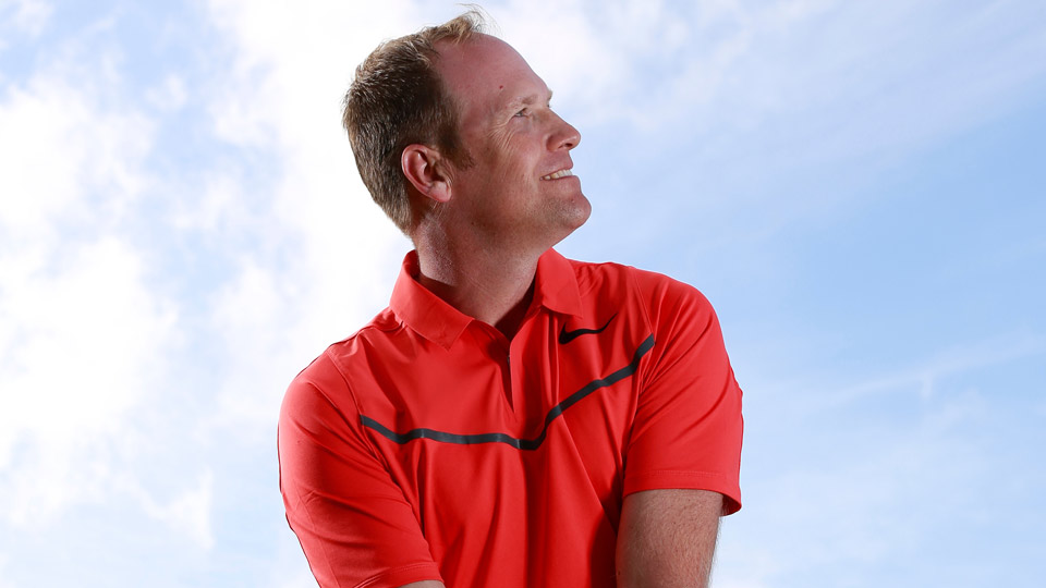 Looking up naturally raises your left shoulder and tilts your spine to the right, creating the ideal setup for launching high-soaring approach shots.