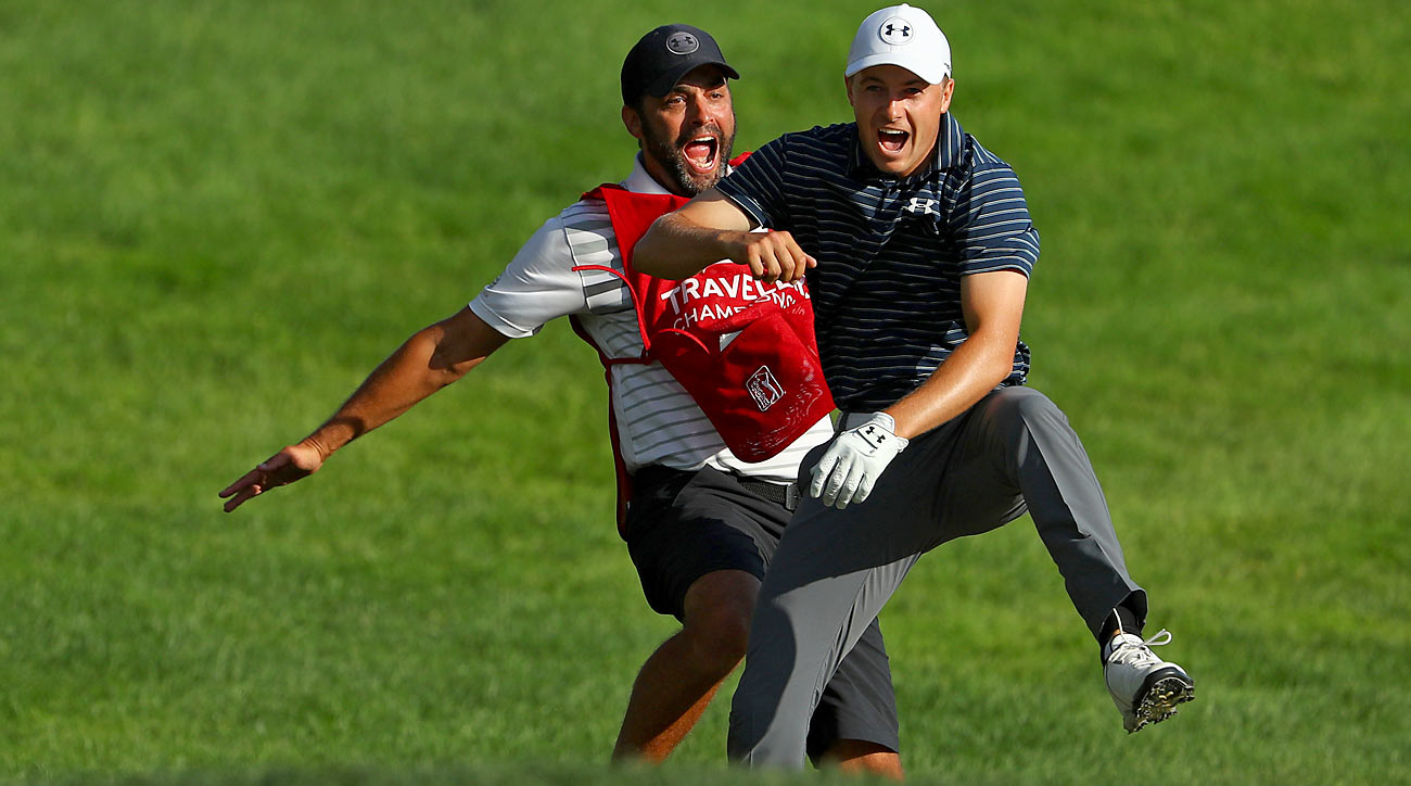 Spieth and Greller cut loose after Spieth's improbable hole-out to win the Travelers.