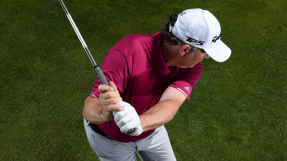"A SIGN OF WEAKNESS: Because your left hand controls clubface angle, cupping your left wrist rotates the face wide open. In order to ""save"" square contact, you'll need to stop your swing before impact, and then it's all arms."