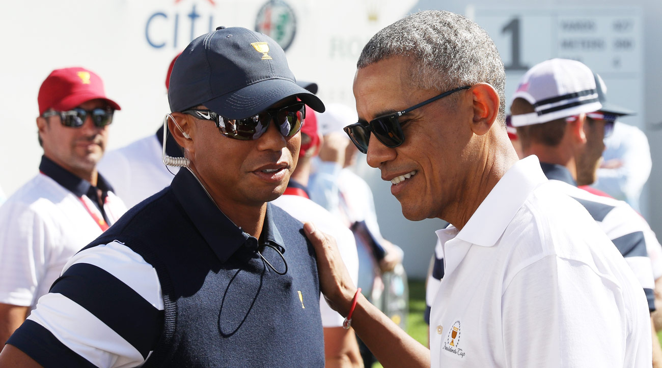 Tiger Woods speaks to former President Barack Obama on the first tee Thursday at the 2017 Presidents Cup.
