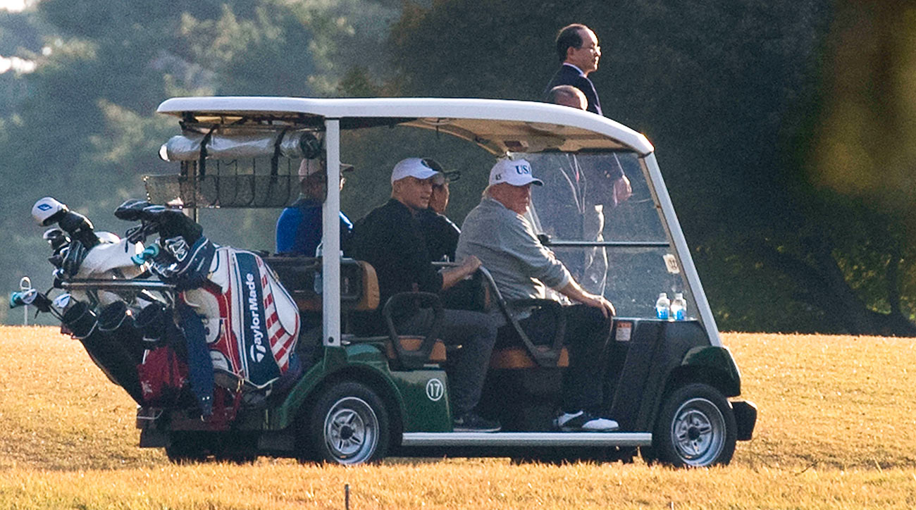 Golf has been a recurring theme for Trump, shown here on the course in November.