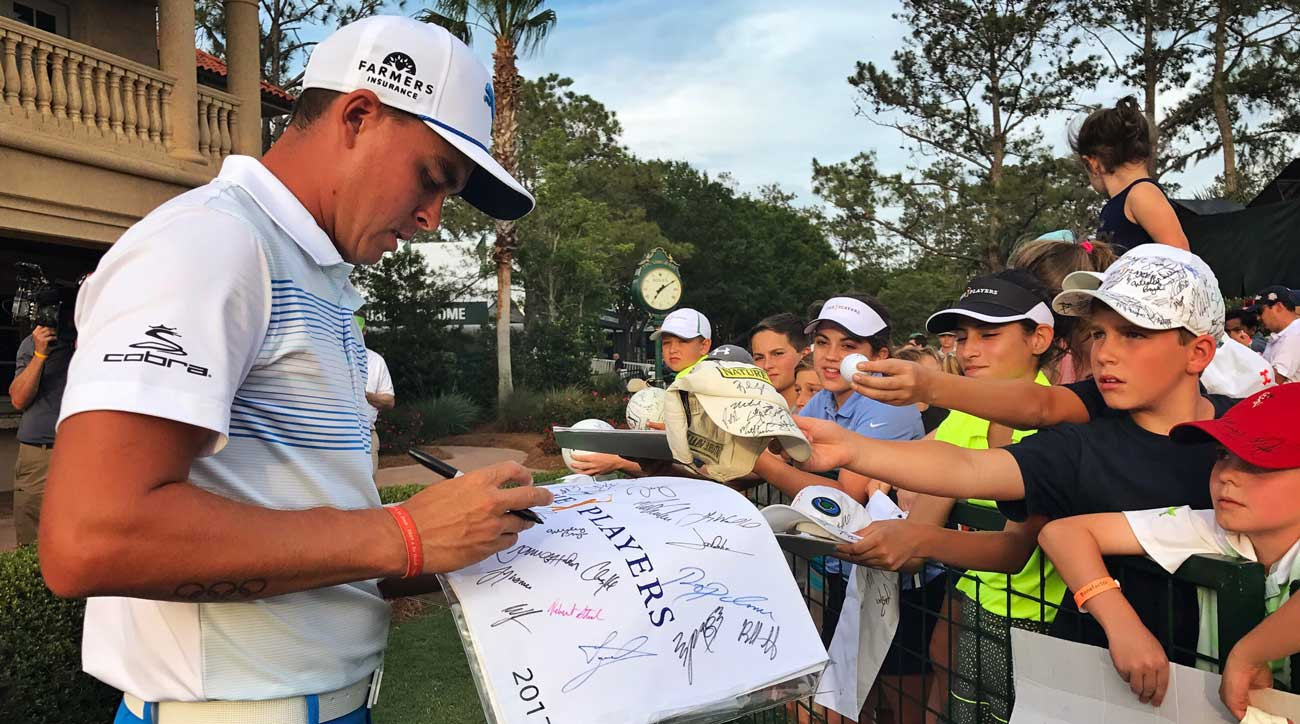 Fowler signs autographs after his round at the Players Championship in 2017.