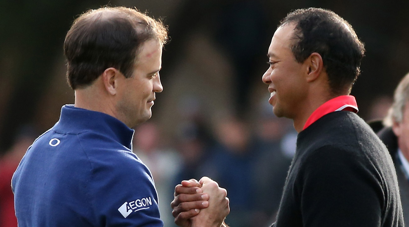 Zach Johnson and Tiger Woods shake hands after Johnson defeated Woods on the first playoff hole during the final round of the 2013 Northwestern Mutual World Challenge.
