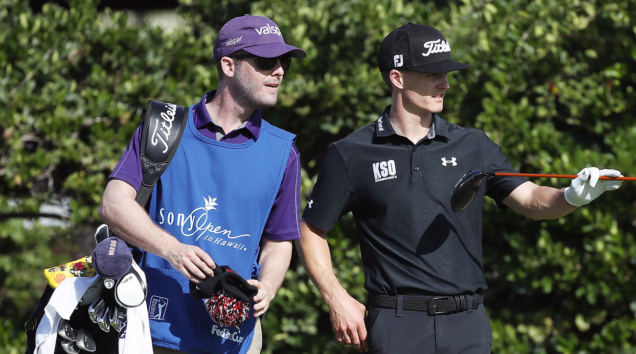 Blayne Barber and caddie Cory Gilmer talk over a shot during the first round of the Sony Open in Hawaii.