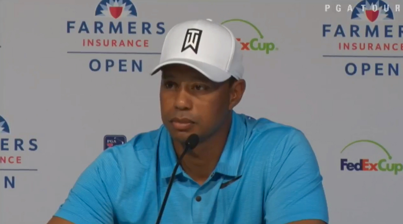 Tiger Woods answers questions from reporters at Torrey Pines prior to the start of the 2018 Farmers Insurance Open.