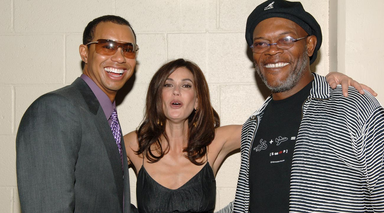Tiger Woods, Teri Hatcher and Samuel L. Jackson during Tiger Jam IX Benefit Concert in 2009.