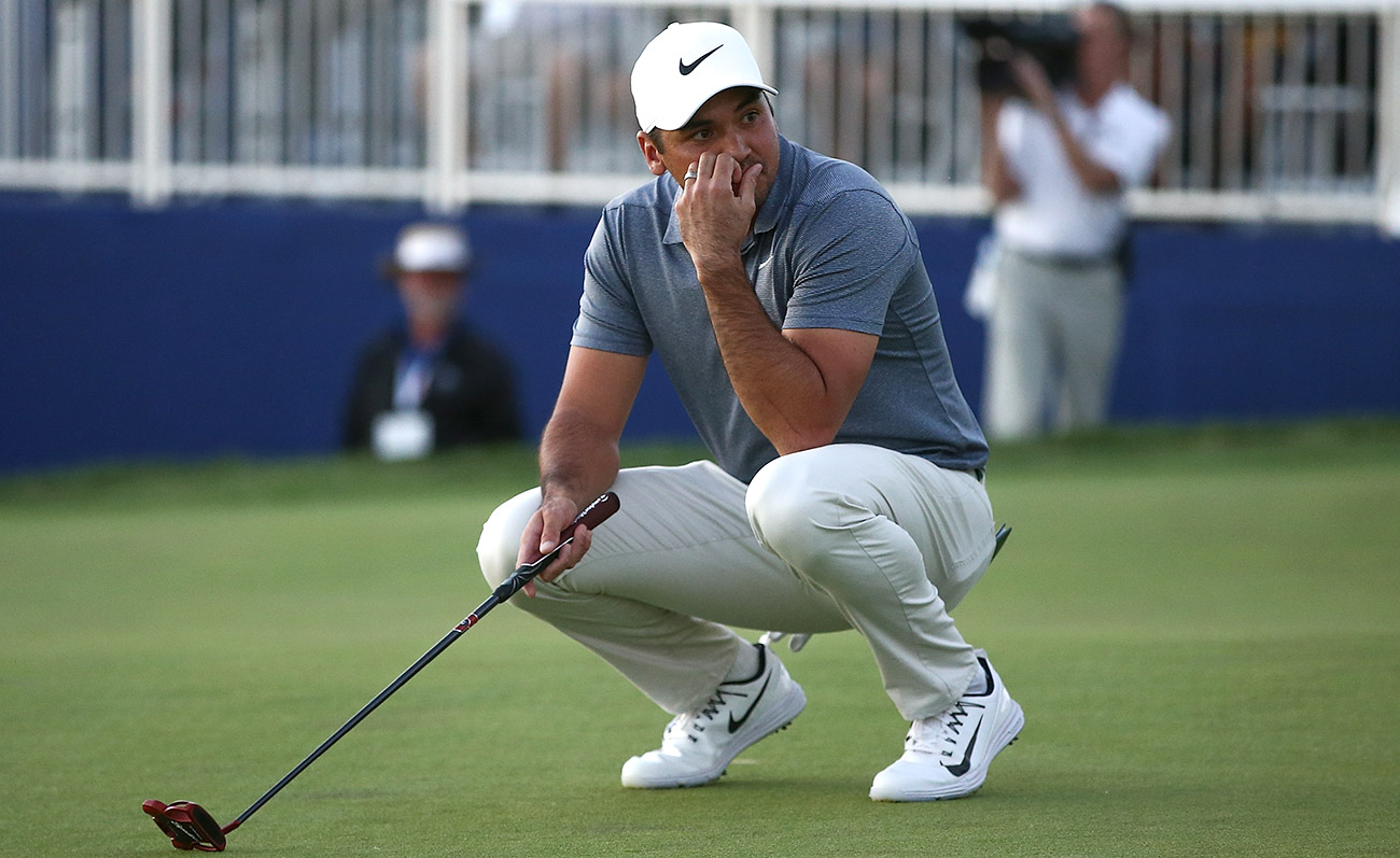 Jason Day reacts after missing a putt on the fourth playoff hole.