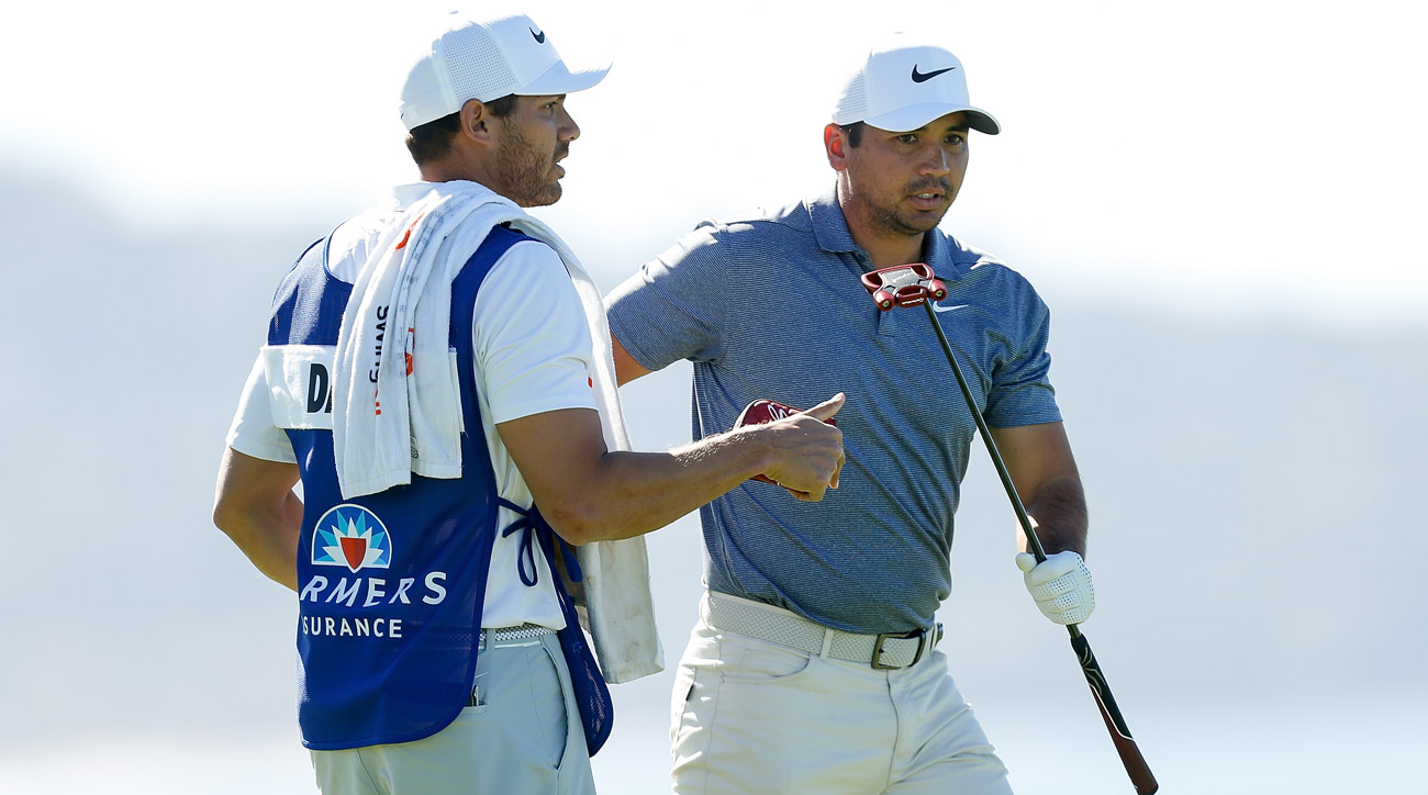 Jason Day talks with his caddie on the fourth green during the final round of the Farmers Insurance Open.