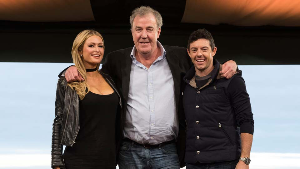 "Paris Hilton and Rory McIlroy pose with the host of ""The Grand Tour,"" Jeremy Clarkson (center)."
