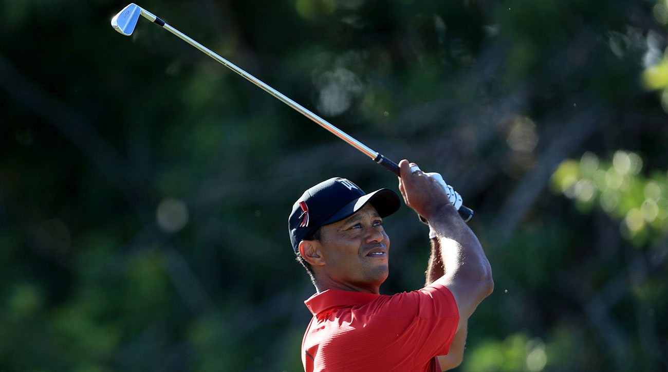 Woods navigated the bruising layout at PGA National in 280 strokes, even par.