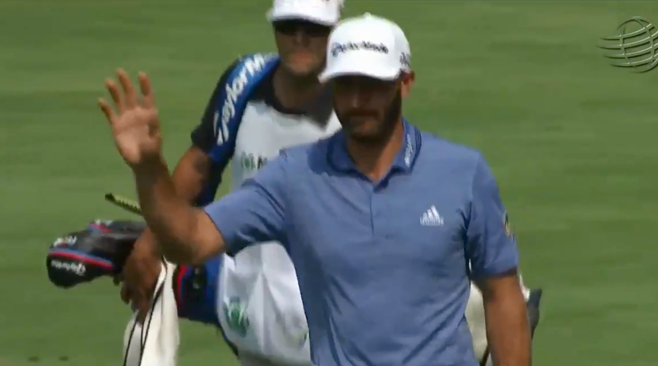 Dustin Johnson waves to the crowd after holing out for eagle in the second round of the WGC-Mexico
