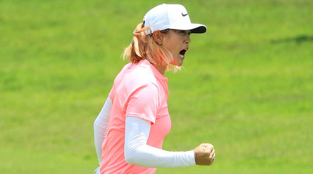 Michelle Wie celebrates her birdie on the 18th green during the final round of the HSBC Women's World Championship.