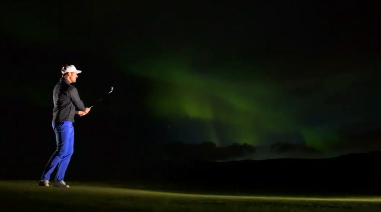 A golfer plays golf in Norway under the Northern Lights in a video posted to Reuters Twitter account.