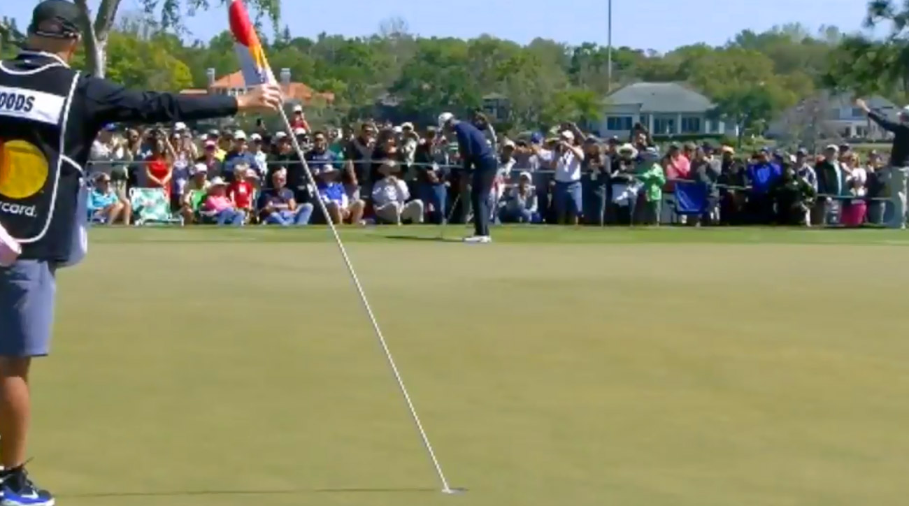 Tiger Woods eyes his birdie putt on the par-3 7th hole at Bay Hill.