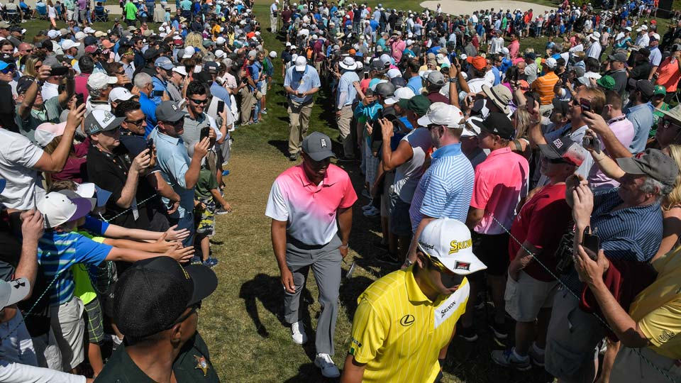 Fans crush in, hoping to catch a glimpse of Tiger Woods.
