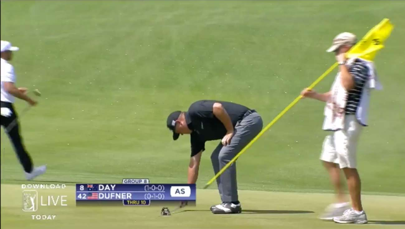 Jason Dufner measures his putt on No. 10 after knocking it in.