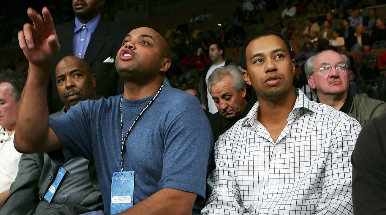 Charles Barkley (front left) sits with Tiger Woods (front right) during the Robert Guerrero and Orlando Salido of Mexico IBF Featherweight Championship fight at the Mandalay Bay Events Center November 4, 2006 in Las Vegas, Nevada.