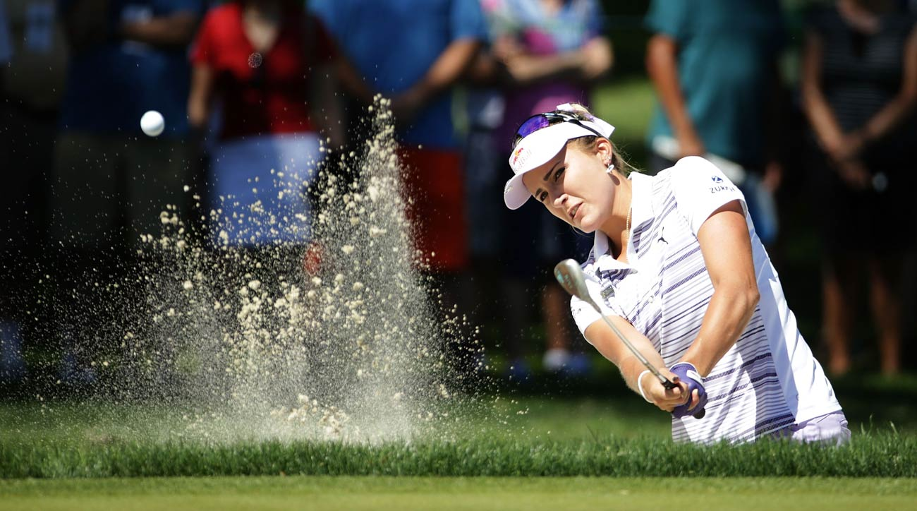 Lexi Thompson plays a bunker shot to the 11th green during the first round of the ANA Inspiration.