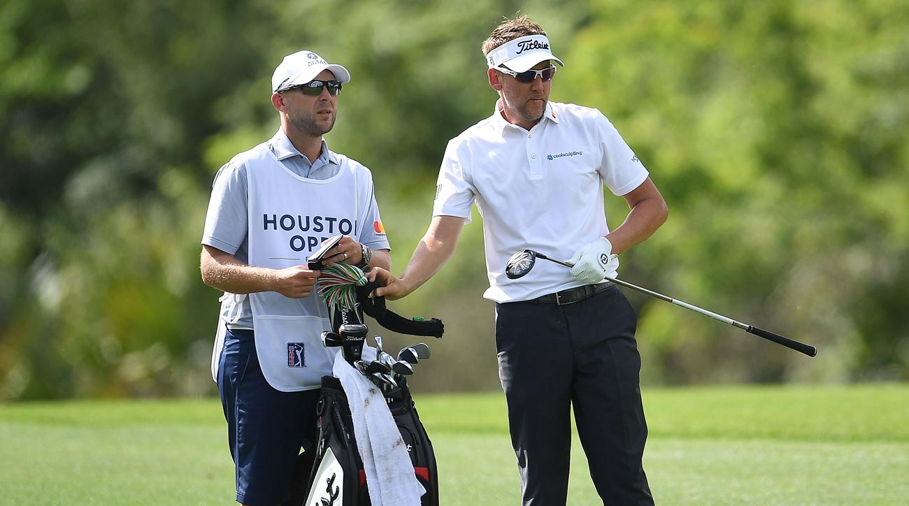Ian Poulter pulls a club from his bag on the 15th hole during the final round of the Houston Open.
