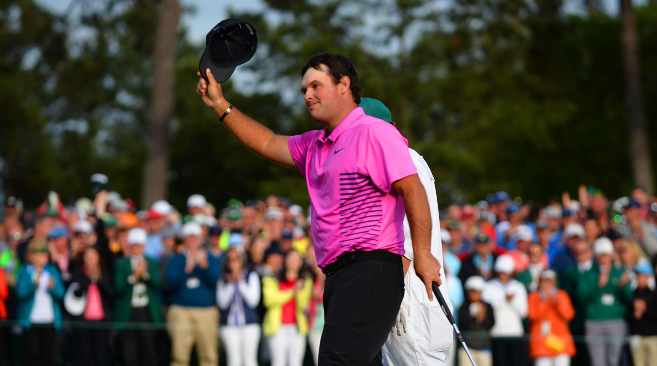 Patrick Reed waves to the crowd after winning the 2018 Masters.