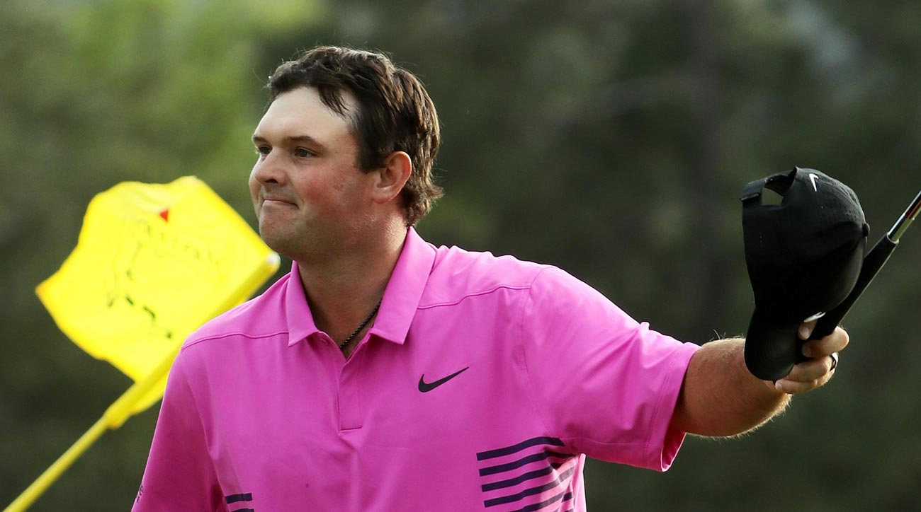 Patrick Reed waves to the crowd after his victory at the Masters