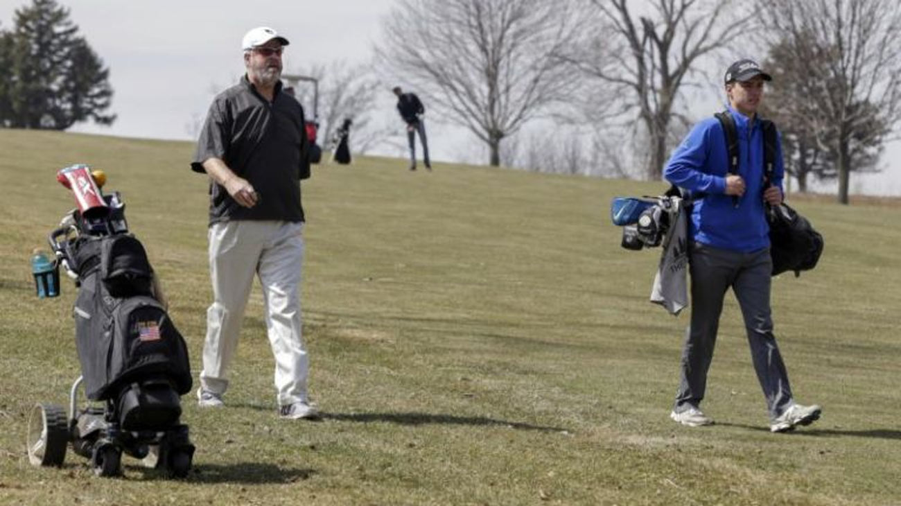 Don Byers, left, practicing for the Bellevue University golf team at Platteview Golf Club in Bellevue, Neb. in April.