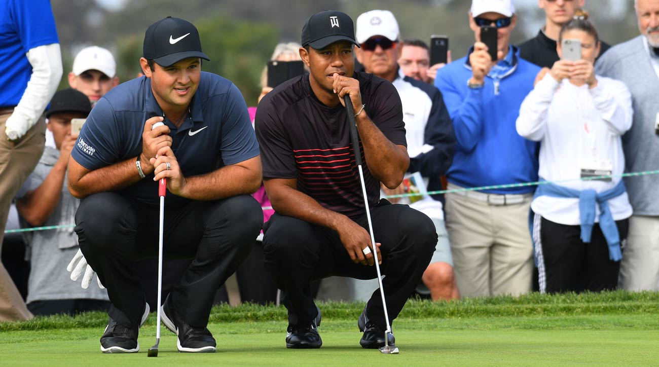 Patrick Reed and Tiger Woods eye their putts during the first round of the 2018 Farmers Insurance Open.