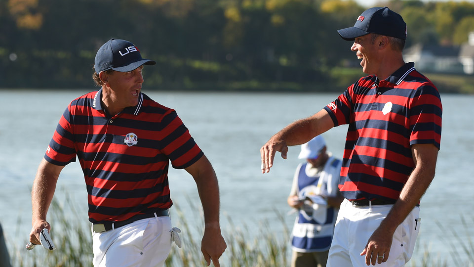 Matt Kuchar shares a playful exchange with Phil Mickelson at the 2016 Ryder Cup at Hazeltine.